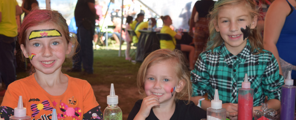 Little girls creating sand art at the Autumn Children's Festival.