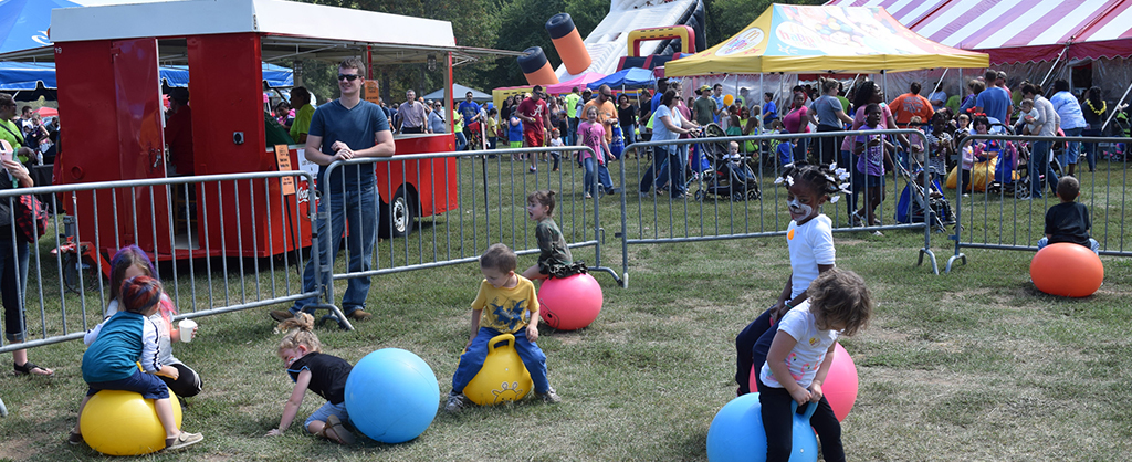 Children bouncing on bouncy balls at the Autumn Children's Festival.