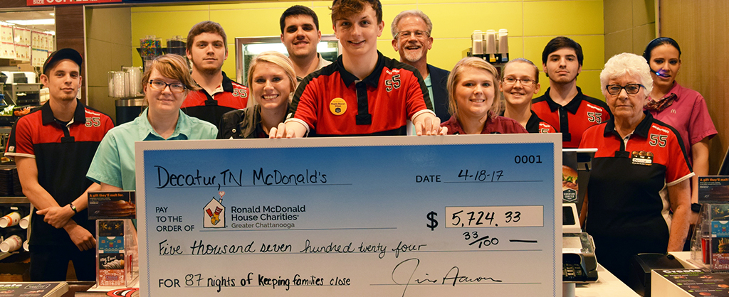 Pictured is the Decatur Tennessee McDonald's employees behind the counter with a large check. The check is for $5,724.33 and represents total funds raised by that McDonald's branch for the Ronald McDonald House.