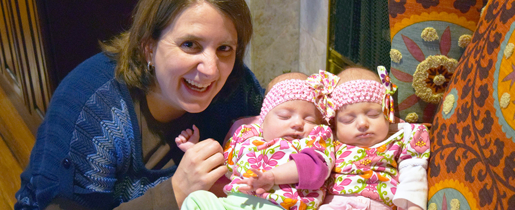 This is the mission page portion of the About Us tab. It is a photo of a mom and her two baby twin daughters.
