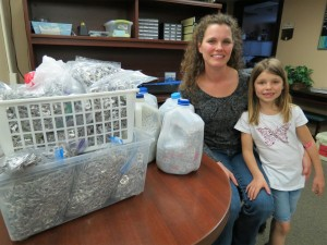 Mother and daughter with their very large collection of soda can pop tabs